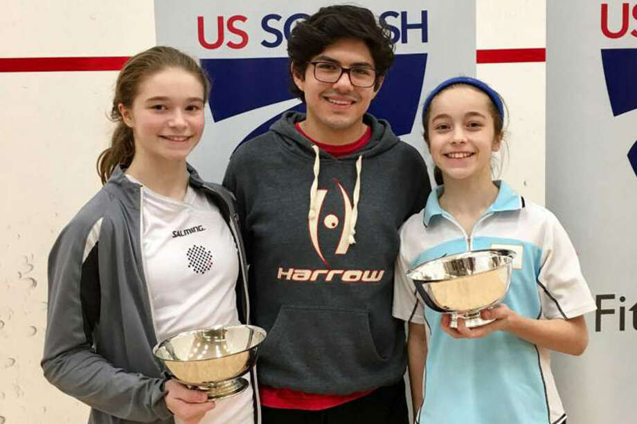 Marina Stefanoni (left) and her sister Lucie pose after both won the junior national championships in Stamford on Mar. 29, 2017. — Contributed photo
