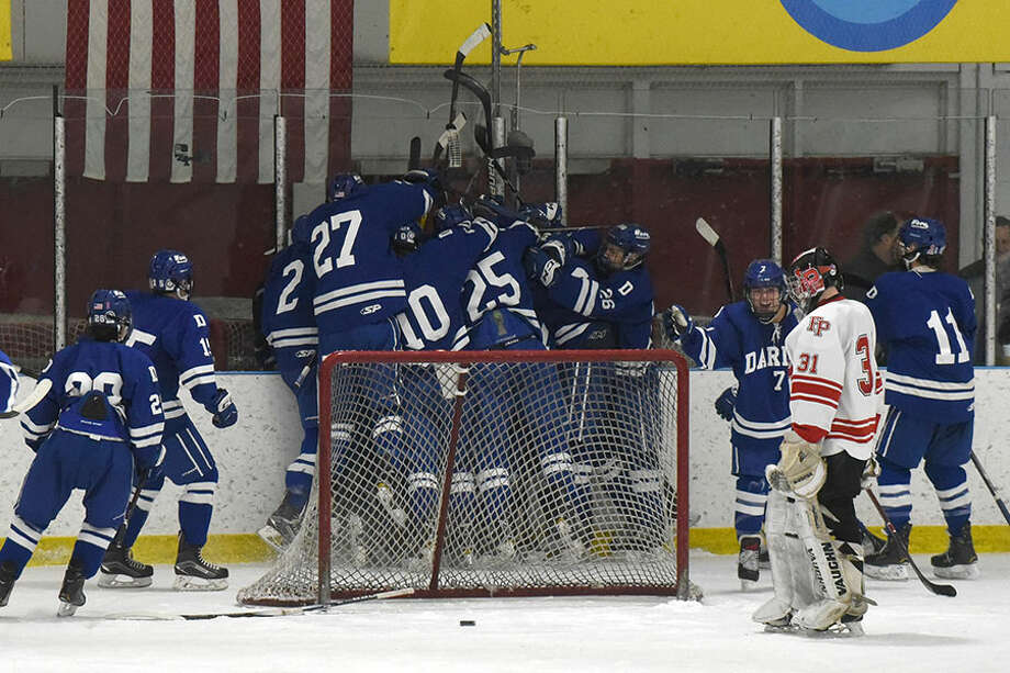 The Darien Blue Wave celebrates after Jack Massey scored in overtime for a 4-3 victory over Fairfield Prep in a boys ice hockey game on Saturday, Jan. 19, at the Wonderland of Ice in Bridgeport. — Dave Stewart/Hearst Connecticut Media photo