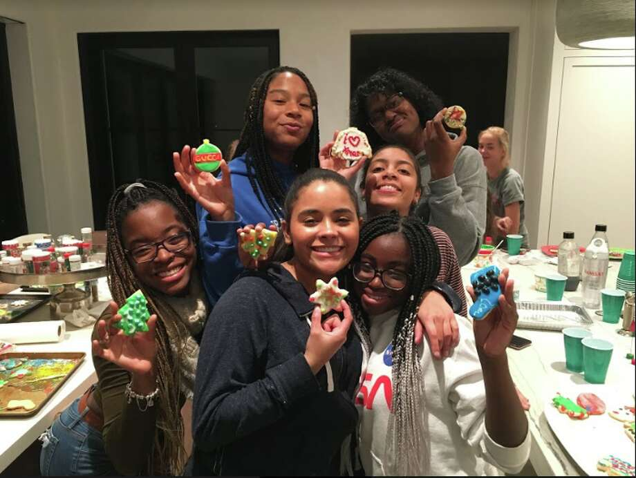 Girls from A Better Chance in Darien decorate cookies at a host family home. Back row: Chelsi, Henyesi, Hassana; front row: Lexi, Angie, Osaru. Missing from photo: E'Sachi, Karys.