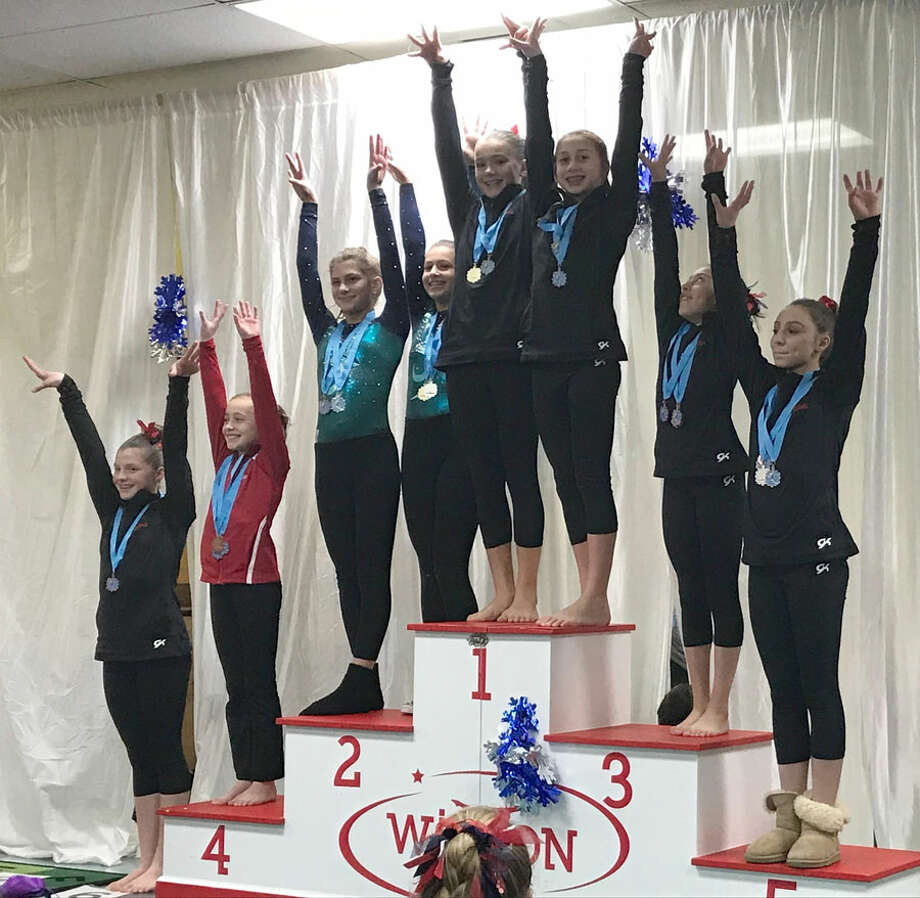 Darien YMCA Level 7 gymnasts Anna Primmer and Julia Decsi tied for first on beam while Lauren Smith placed sixth, Kristie Alianiello fifth and Sofia Alarcon-Frias third at the Snowflake Invitational meet in Wilton.