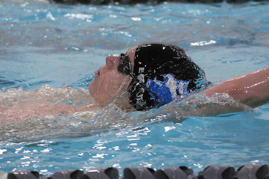 Darien's Spencer Erickson swims to a first-place finish in the 100-meter backstroke during the Wave's 108-74 win over Staples in Westport on Friday, Jan. 4. — Dave Stewart/Hearst Connecticut Media photo