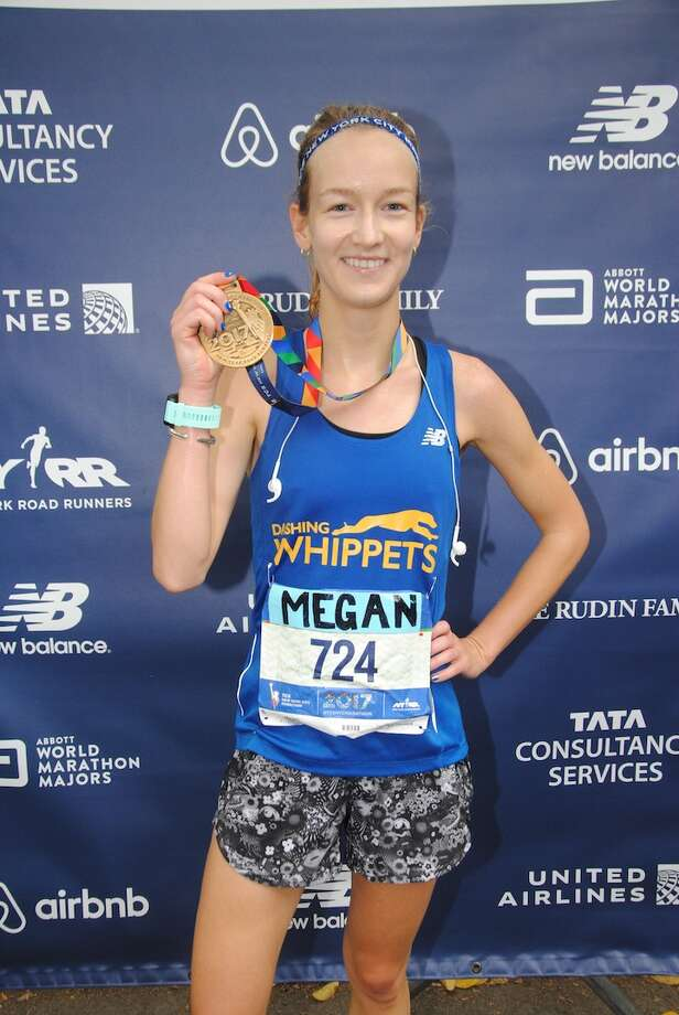 Former Wave captain Megan Keane earns her medal at the well known marathon.