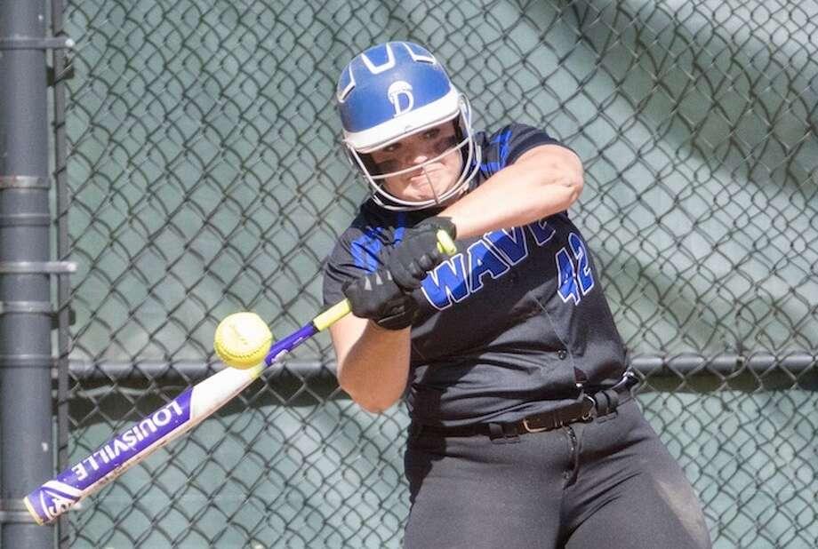 BLUE CRUSH — Sophia Barbour with the blast. She's had plenty this season. Courtesy Darien Athletic Foundation / (c)Mark Maybell