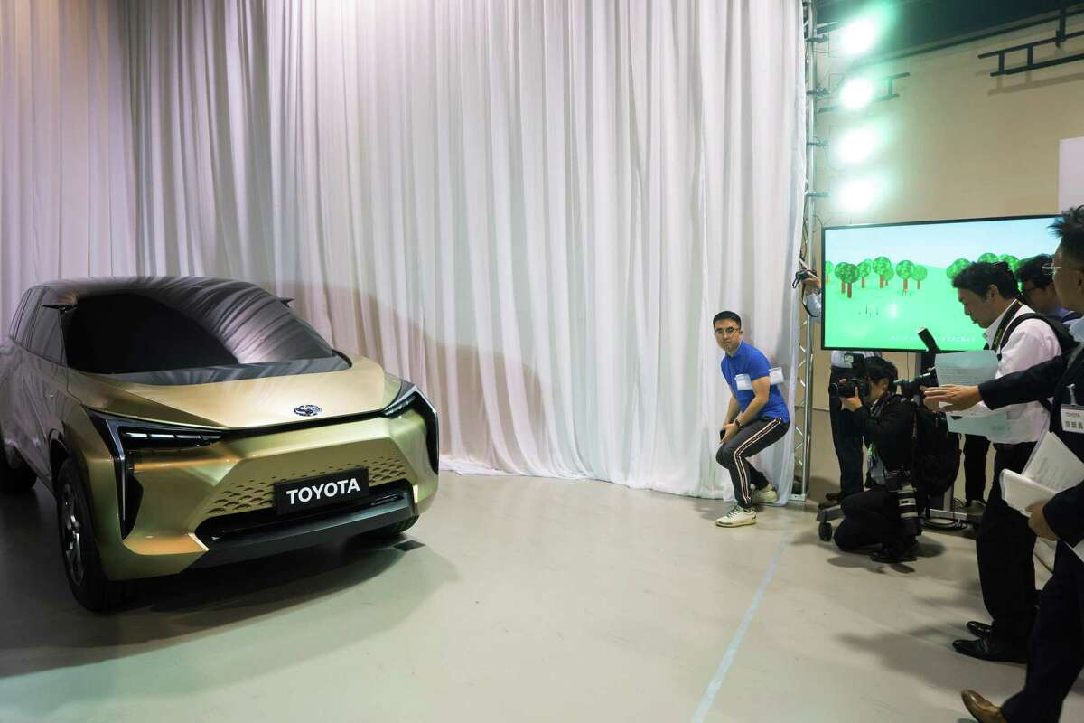 A Toyota concept electric vehicle is displayed during a news conference in Tokyo, Japan.
