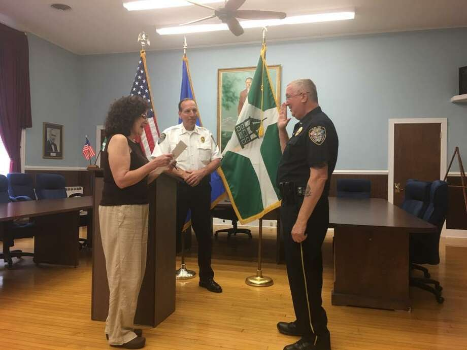 After eight years as a New Milford police lieutenant, Lawrence Ash, right, was sworn in as captain on June 19, 2019. He was joined at the ceremony by Chief Spencer Cerruto, center. Photo: Pete Bass / Facebok