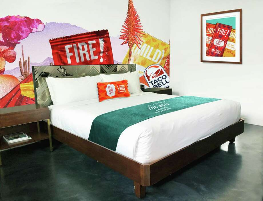 But can I buy that pillow? A Taco Bell Hotel is opening this summer and you can book a stay. Photo: Taco Bell