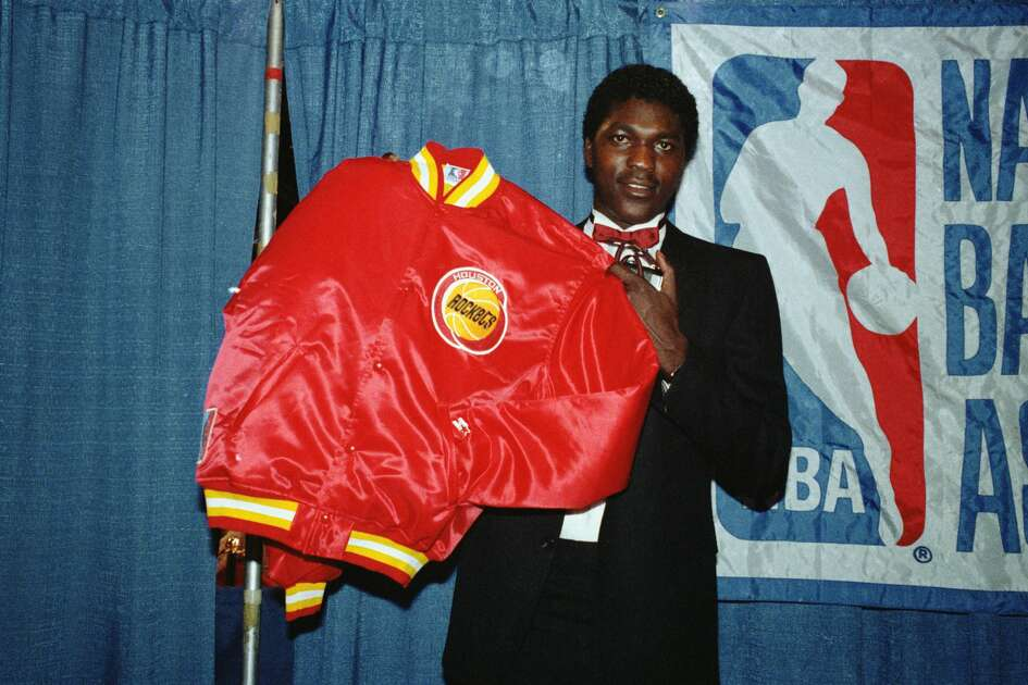 Hakeem Olajuwon, selected by the Houston Rockets 6/19 as first choice in the NBA draft, displays his new team jacket.