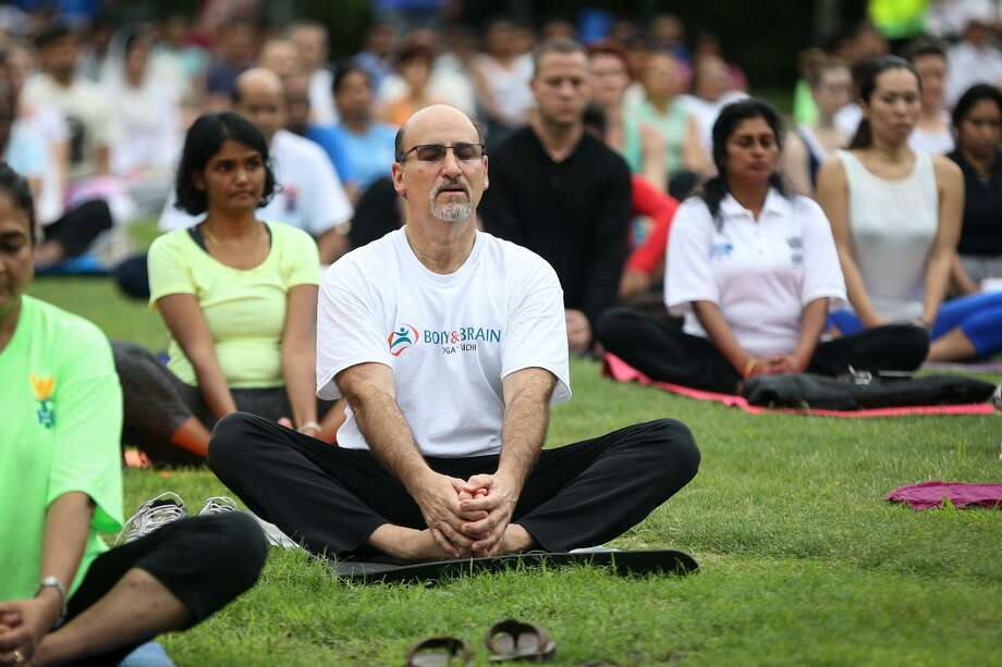 Attendees of the International Yoga Day celebration, hosted by The Hindu Temple of The Woodlands, take part in meditation and yoga on Saturday, June 24, 2017, at Town Green Park. Photo: Michael Minasi, Staff Photographer / Houston Chronicle / © 2017 Houston Chronicle