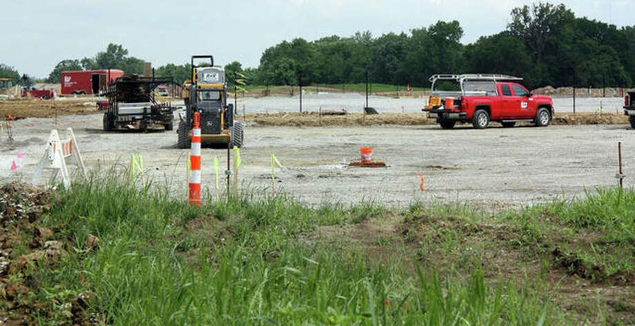 One of the parking lots at Plummer Family Park starts to come into focus, mid-ground, while in the background, one of the baseball/softball diamonds starts to come together Wednesday. Photo: Charles Bolinger | The Intelligencer