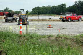 One of the parking lots at Plummer Family Park starts to come into focus, mid-ground, while in the background, one of the baseball/softball diamonds starts to come together Wednesday.