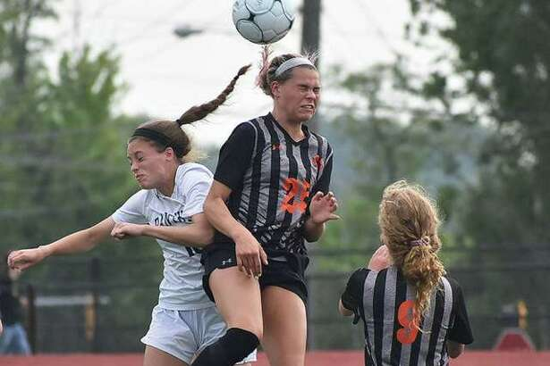 Edwardsville's Hannah Bielicke goes up for a header on a 50-50 ball at midfield during the first half of a game against O'Fallon in the Class 3A Moline Sectional semifinals in Collinsville.