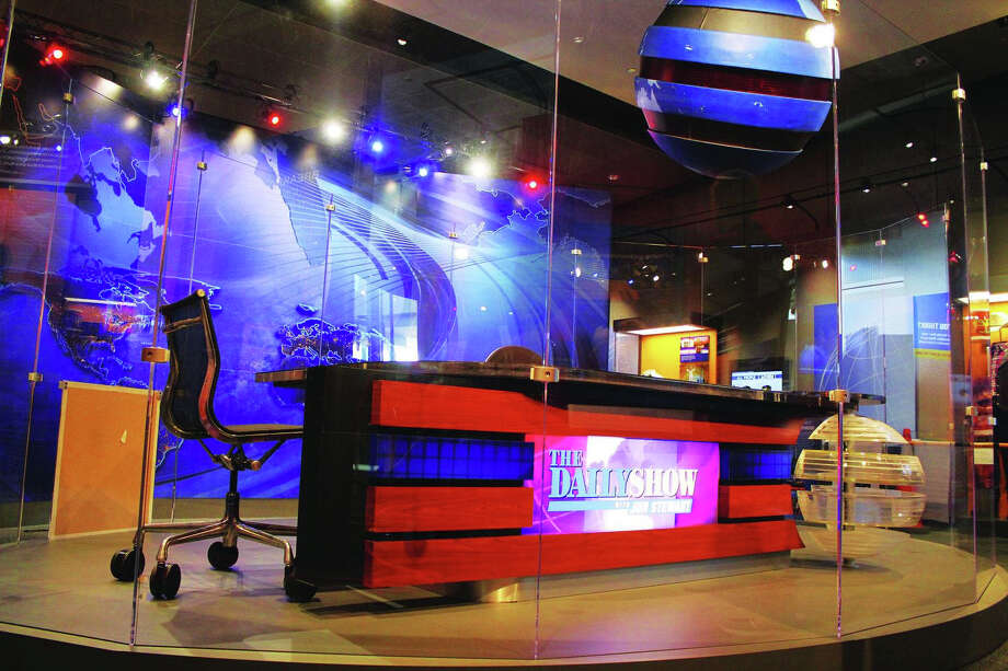The desk that Jon Stewart sat behind from 2007 until his final episode is the centerpiece of the Newseum's exhibit. The desk was brought in as part of a major redesign of the show's set completed eight years into Stewart's run. Photo: Washington Post Photo By Ellen Collier / The Washington Post