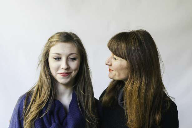 Close shot of mother looking humorously at her teenage daughter.