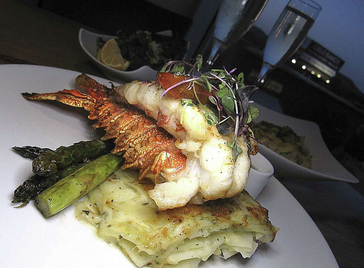 Tristan Island lobster tail's ever-changing preparation might include Gruyère potato gratin and asparagus at Silo Terrace Oyster Bar.