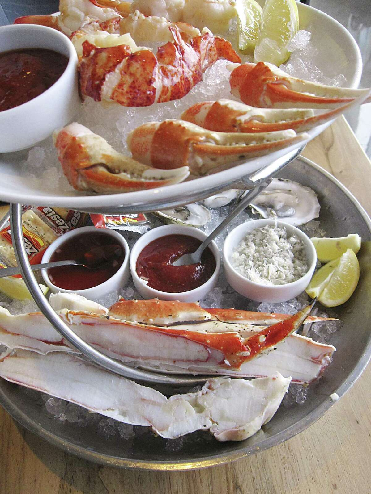A large chilled seafood tower includes lobster, shrimp, crab claws, oysters and king crab legs at Silo Terrace Oyster Bar.