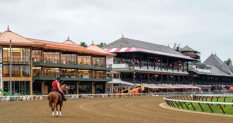 An outrider walks the main track at 5:30 am and prepares for the first horses of year to train on the Main track at the Saratoga Race Course which opens officially for training Thursday June 20, 2019 in Saratoga Springs, N.Y. The 2019 season opens July 11 and runs through September 2nd. Photo Special to the Times Union by Skip Dickstein.