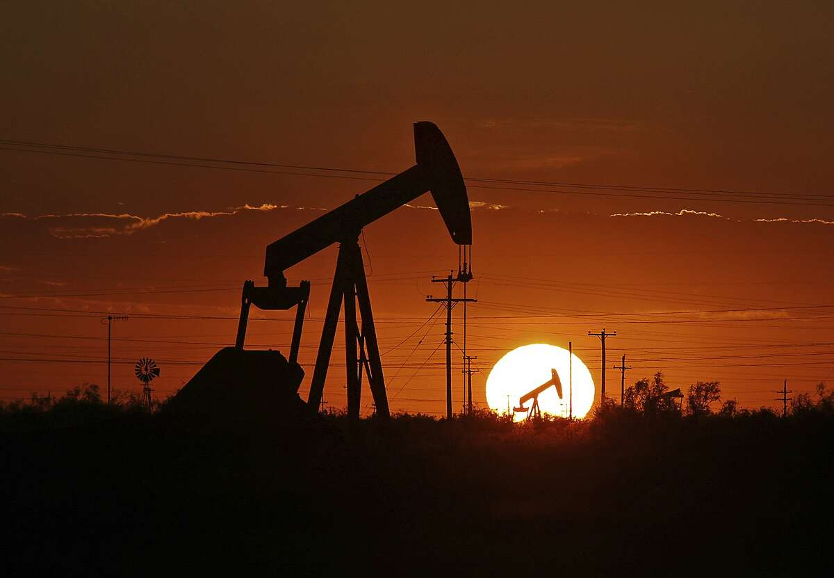 FILE - In this June 11, 2019, file photo a pump jack operates in an oil field in the Permian Basin in Texas.