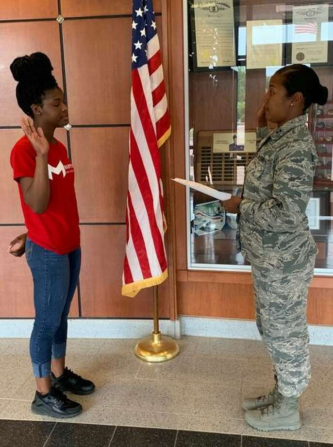 Belleville native Alayah Douglas enlisted in the Illinois Air National Guard during a ceremony on June 3 at Scott Air Force Base. Douglas enlisted into the 126th Air Refueling Wing - Mission Support Group and will serve as a Personnel Airman Photo: Courtesy Of The Illinois Air National Guard
