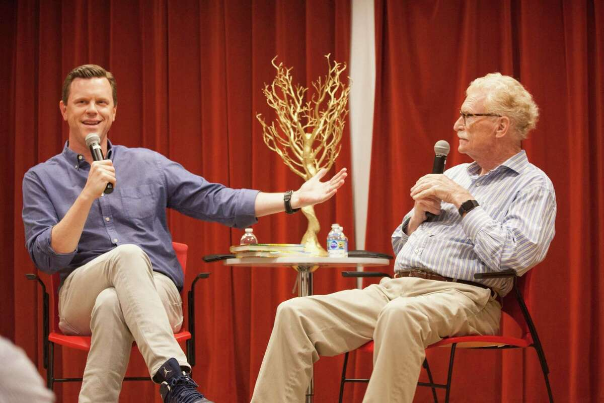 """Willie Geist, co-host of MSNBC's Morning Joe, interviewed his father Bill Geist, on his new book """"Lake of the Ozarks"""" at the New Canaan Library on May 19, 2019. Bill was a former journalist for CBS Sunday Morning."""