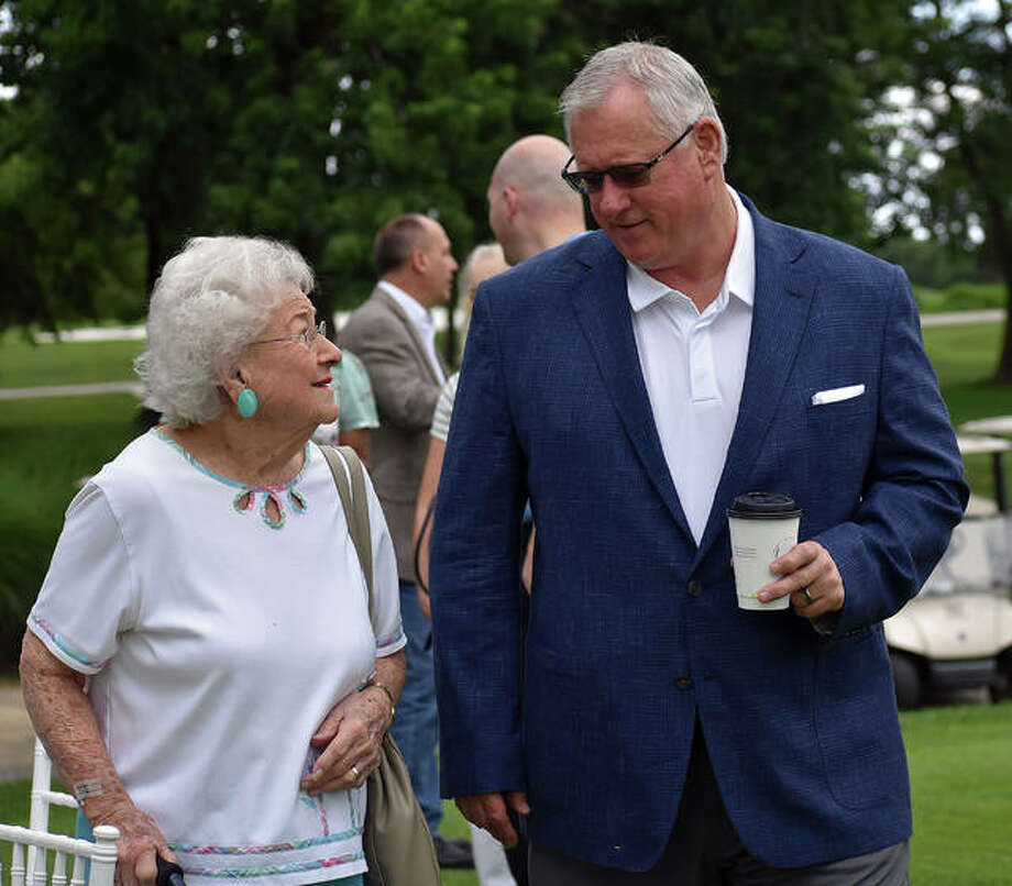 SIUE athletic director Dr. Brad Hewitt and Bev Gallatin joke around before the start of Thursday's ground-breaking ceremony inside Sunset Hills Country Club in Edwardsville. Photo: Matt Kamp/The Intelligencer
