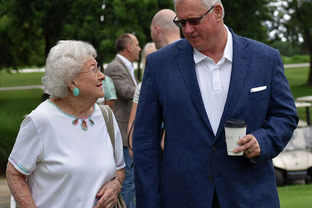 SIUE athletic director Dr. Brad Hewitt and Bev Gallatin joke around before the start of Thursday's ground-breaking ceremony inside Sunset Hills Country Club in Edwardsville.