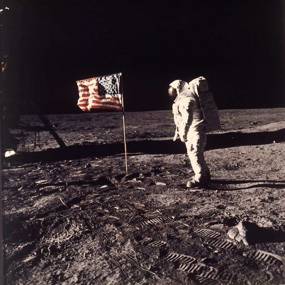 FILE - In this image provided by NASA, astronaut Buzz Aldrin poses for a photograph beside the U.S. flag deployed on the moon during the Apollo 11 mission on July 20, 1969. A new poll shows most Americans prefer focusing on potential asteroid impacts over a return to the moon. The survey by The Associated Press and the NORC Center for Public Affairs Research was released Thursday, June 20, one month before the 50th anniversary of Neil Armstrong and Aldrin's momentous lunar landing. (Neil A. Armstrong/NASA via AP) Photo: Neil A. Armstrong, Associated Press