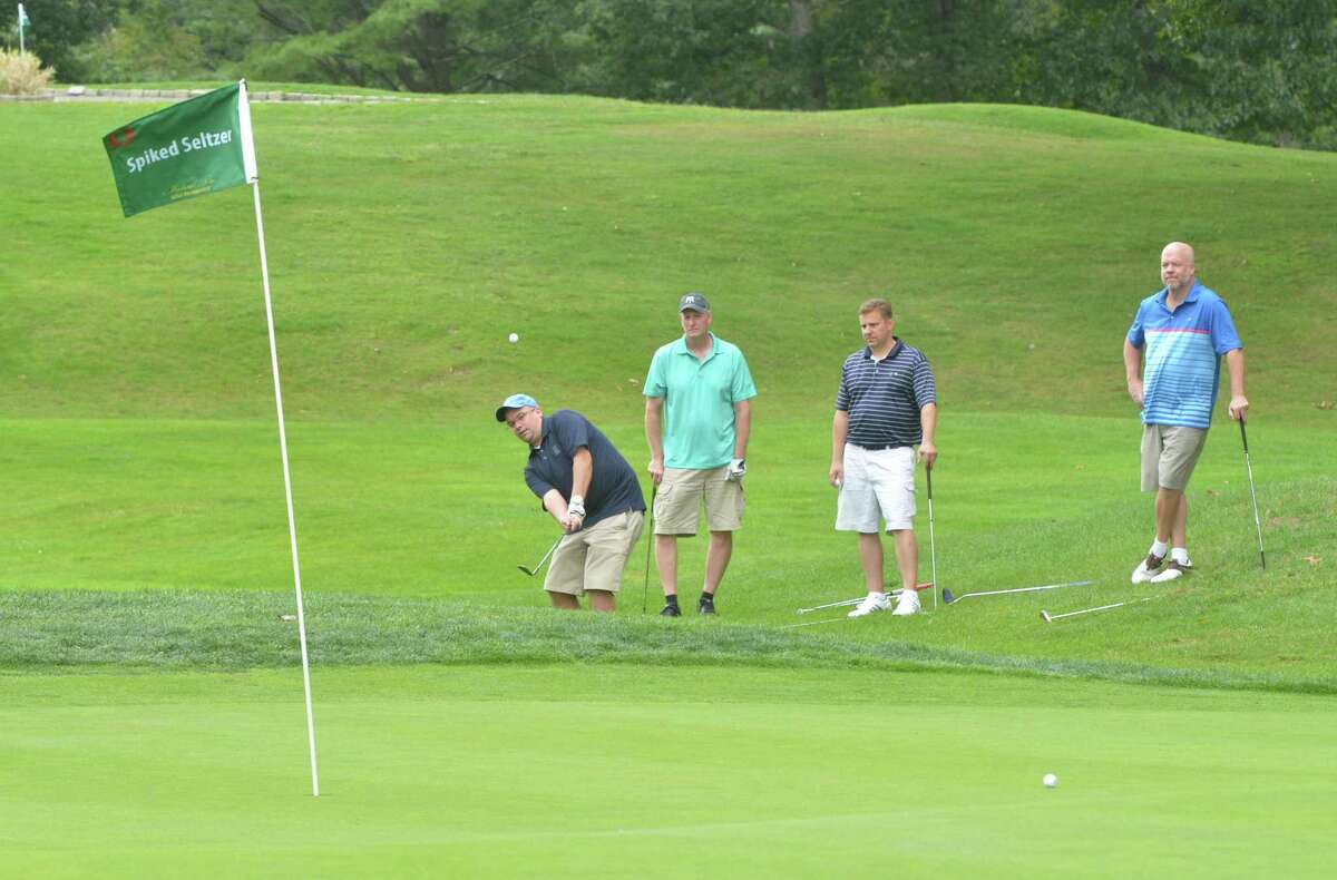 Frank Tkazyik gets on the green with his foursome during the fourth annual fundraiser, Play it Forward Golf Tournament in memory of burn victim Michael Ness and to help raise funds to support Connecticut's only regional burn center on Monday September 18, 2017 at Oak Hills Park in Norwalk Conn.