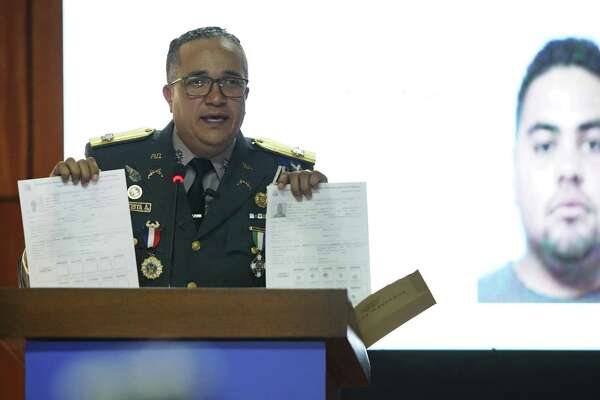 Director of the National Police, General Ney Aldrin Bautista Almonte, gives a press conference about the intellectual authors of the attack on former Boston Red Sox slugger David Ortiz, in front of an image of a man identified by authorities as Victor Hugo Gomez in Santo Domingo, Dominican Republic, Wednesday June 19, 2019. According to Bautista Almonte, Ortiz was shot by a gunman who mistook him for the real target, Sixto David Fernández, who was seated at the same table with the former baseball star on the night of June 9, and the attempted murder was ordered from the United States by Victor Hugo Gomez, Fernández's cousin and an associate of Mexico's Gulf Cartel. (AP Photo/Roberto Guzman)