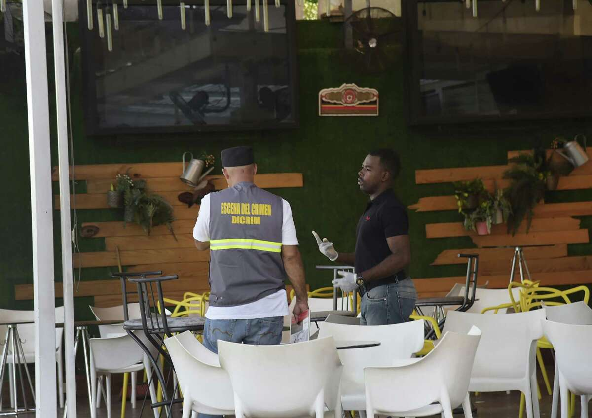 Investigative police collect evidence at the Dial Bar and Lounge where former Boston Red Sox slugger David Ortiz was shot the previous night in Santo Domingo, Dominican Republic, Monday, June 10, 2019. Dominican National Police Director Ney Aldrin Bautista Almonte said Ortiz was at the bar around 8:50 p.m. Sunday when a gunman approached from behind and shot him at close range. (AP Photo/Luis Gomez)