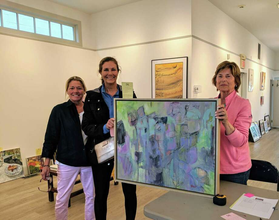 """At the Table"" chairwoman Amy Schott, left, with Rowayton Arts Center Exhibiting Artists Britt Bair and Hanneke Goedkoop, as Bair drops off her ""Birthday Dinner"" painting for RAC's Community Sponsored Awards show, which opens June 23, with a reception from 4 to 6 p.m. Photo: Rowayton Arts Center / Contributed Photo"