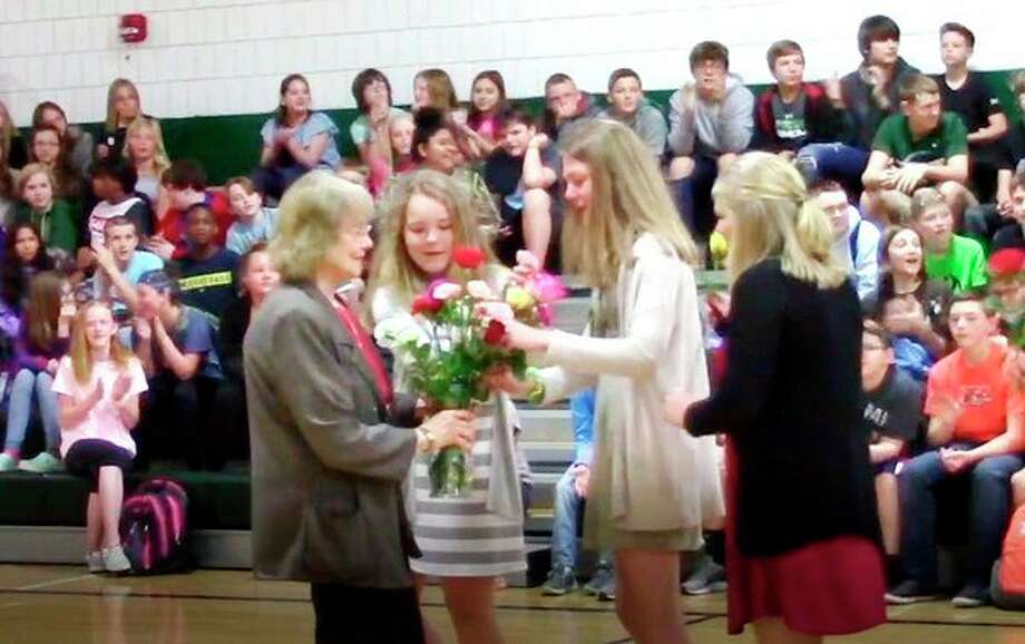 The entire Laker Junior High recently gathered in the junior high gym to honor retiring science teacher Diana Schulz, who has been with the district for 29 years. During the ceremony, 29 students, each carrying a flower, walked into the gym and placed the flowers in a vase held by Schulz, who was brought to tears. She watched a slideshow of photos of herself throughout her years at Lakers, and the slideshow featured images of newsworthy and cultural events for each of her 29 years. The slideshow was created by a group of eighth graders, with the help of teacher Julie Stoyka. (Submitted Photo)