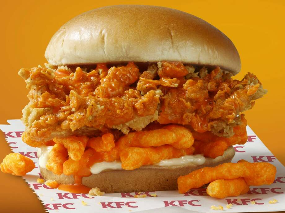 KFC is rolling out a fried chicken sandwich topped with Cheetos.  The sandwich hits menus across the US on July 1 and will only be available for four weeks. Photo: KFC