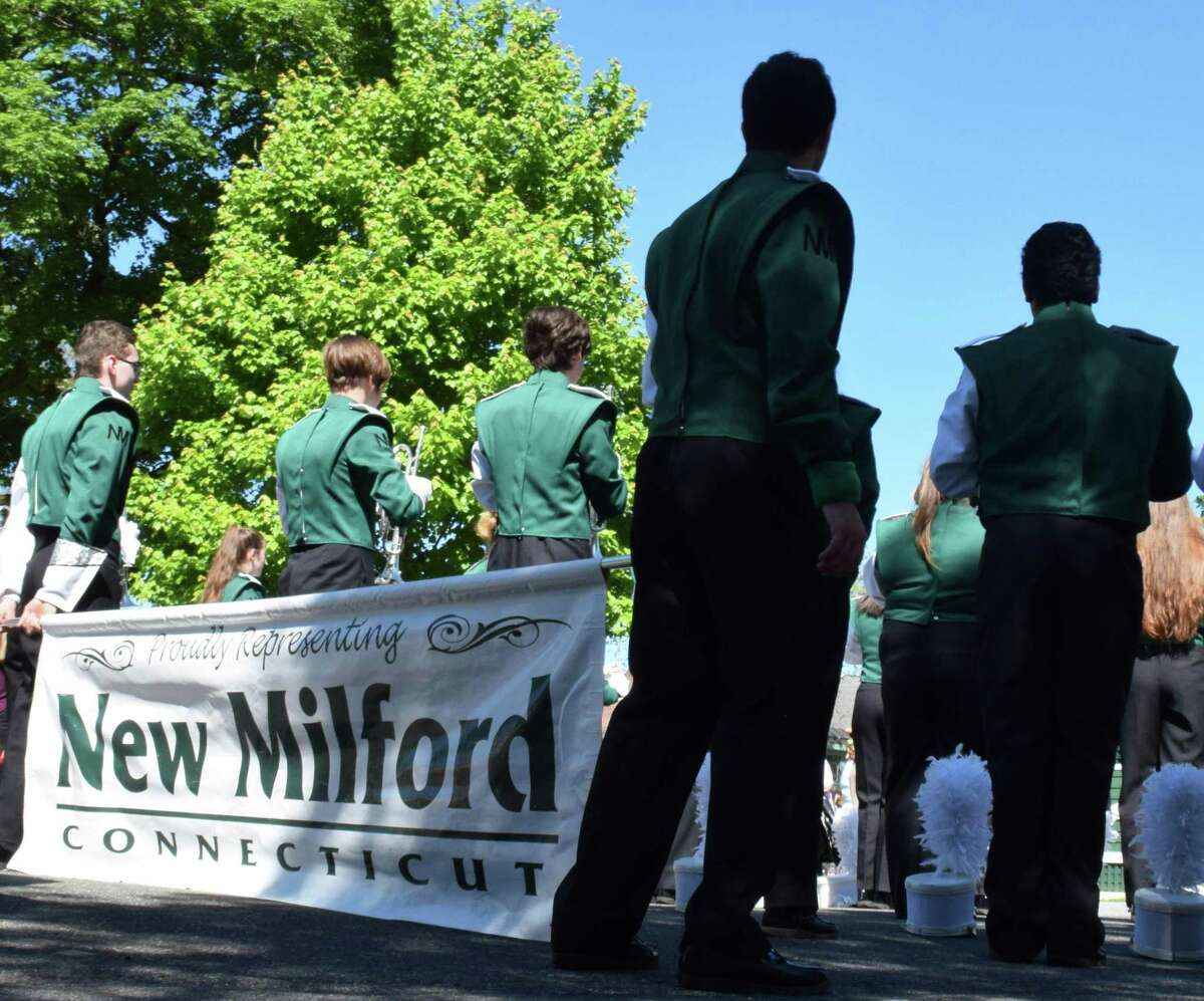 File photo of the New Milford High School Marching Band. May 27, 2019. Above, members of the New Milford High School band wait for directions from their drum majors.
