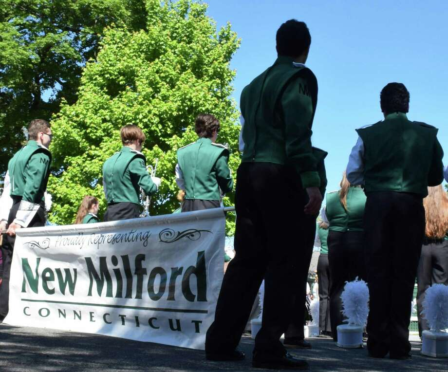 File photo of the New Milford High School Marching Band. May 27, 2019. Above, members of the New Milford High School band wait for directions from their drum majors. Photo: Deborah Rose / Hearst Connecticut Media / The News-Times  / Spectrum