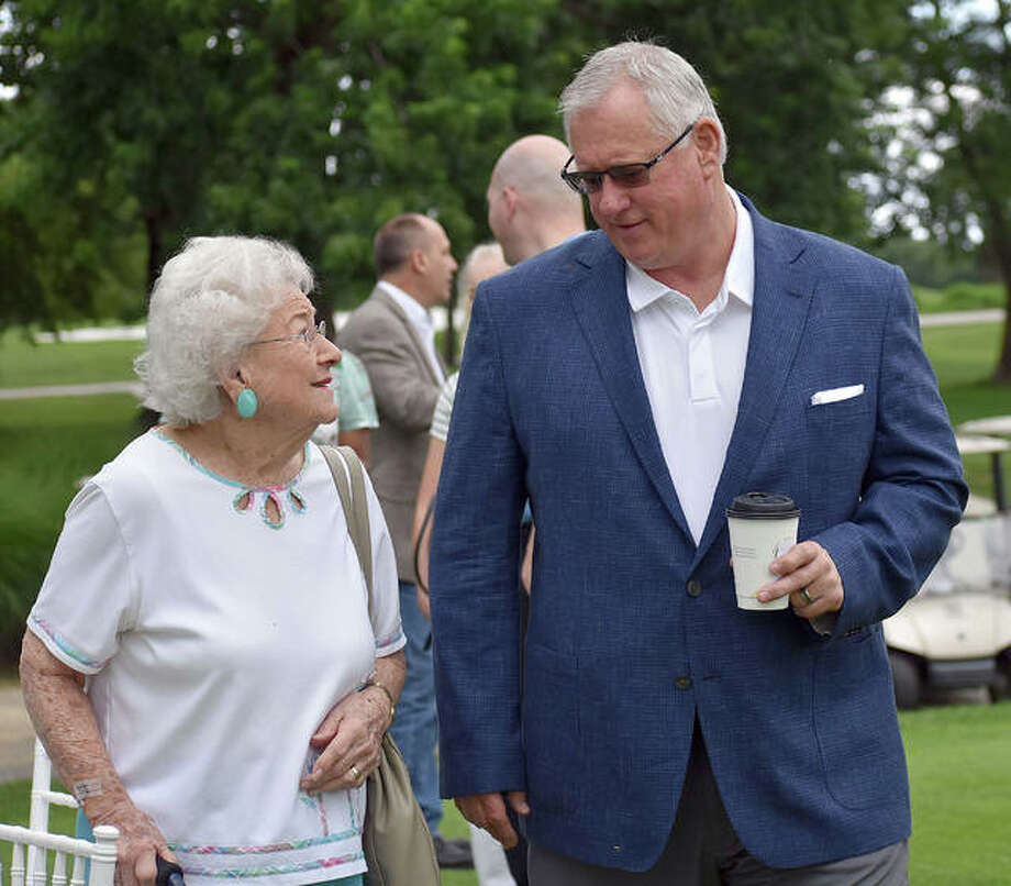 SIUE athletic director Dr. Brad Hewitt and Bev Gallatin chat before the start of Thursday's ground-breaking ceremony at Sunset Hills Country Club. Photo: Matt Kamp   For The Telegraph
