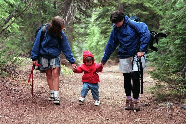 Laura Robinson, 11, and Marcia Bruno, of Seattle, walk Bruno's 22-month-old daughter Charlotte Appleford, down the trail to Esmeralda Basin in the Teanaway Valley.. This trail is particularly good for children.
