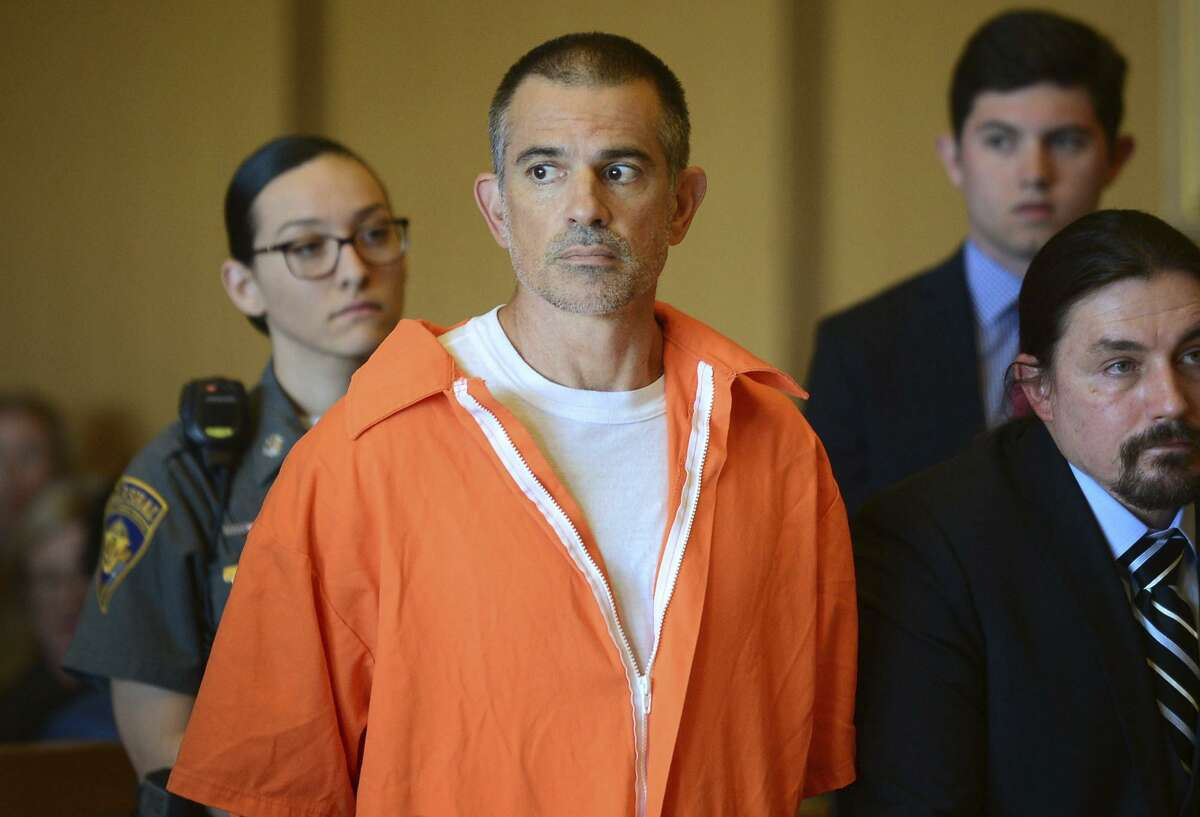 Fotis Dulos stands during a hearing at Stamford Superior Court, Tuesday, June 11, 2019 in Stamford, Conn. Fotis Dulos, and his girlfriend, Michelle Troconis, have been charged with evidence tampering and hindering prosecution in the disappearance of his wife Jennifer Dulos. The mother of five has has been missing since May 24. (Erik Trautmann/Hearst Connecticut Media via AP, Pool)