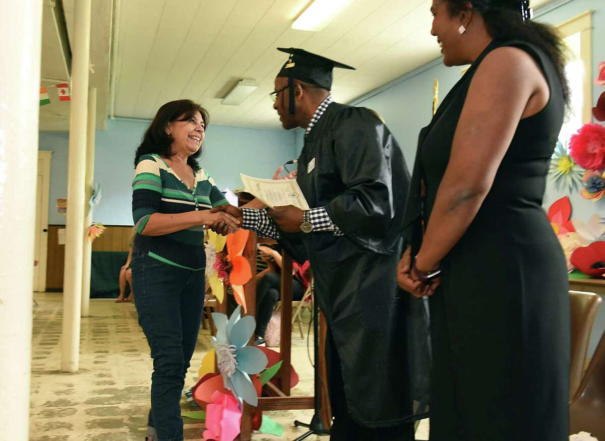 Lucia Mesa of Colombia, left, receives her certificate as Refugee and Immigrant Support Services of Emmaus (RISSE) hosts its first graduation for immigrants and refugees completing their English language studies on International Refugee Day at Emmaus United Methodist Church on Thursday, June 20, 2019 in Albany, N.Y. (Lori Van Buren/Times Union)