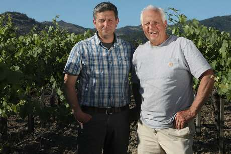 Peter Heitz, left, and his dad Gary Heitz at the Shypoke Vineyard in Calistoga, where their relatives first planted Charbono in 1904. Photo: Liz Hafalia / The Chronicle
