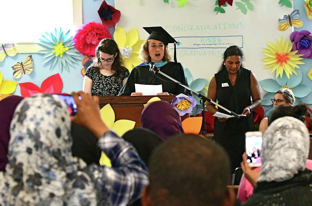 Patty Jokiel, teacher at Refugee and Immigrant Support Services of Emmaus (RISSE) comments on the adult literacy program as RISSE hosts its first graduation for immigrants and refugees completing their English language studies on International Refugee Day at Emmaus United Methodist Church on Thursday, June 20, 2019 in Albany, N.Y. (Lori Van Buren/Times Union)