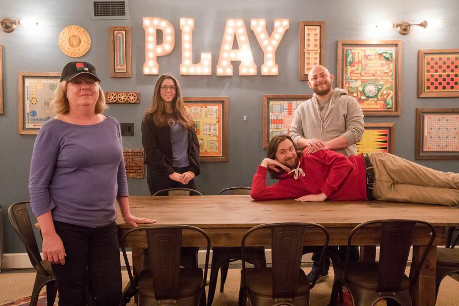 (Left to right) Maggie Ziomek, Allie Jordan, Andrew Holmgren (on table) and Greg Gettle work at Palace Games. Located at the Palace of Fine Arts in San Francisco, Palace Games has three popular escape rooms that attract fans from all around the world. Photo: Douglas Zimmerman/SFGate.com