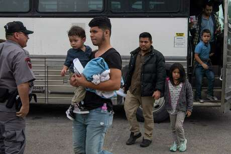 Central American migrant families arrive at a Catholic Charities respite center after being released from federal detention in McAllen, Texas on June 12, 2019.