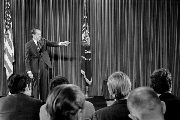FILE-- President Richard Nixon at a news conference at the White House in Washington, Dec. 10, 1970. Some Democrats say opening an impeachment inquiry could help the House overcome the president's blockade of its investigations. But others say that could backfire politically. Nixon resigned in 1974 to avoid impeachment. (Mike Lien/The New York Times)