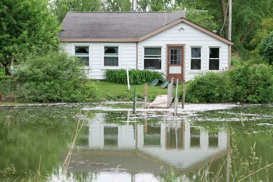 High water around the shores of Lake Huron has docks submerged on Seagull Avenue in Unionville. (Coulter Mitchell/For the Tribune)