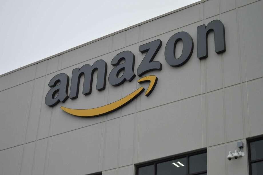 A sign on the outside of Amazon's North Haven fulfillment center Photo: File Photo