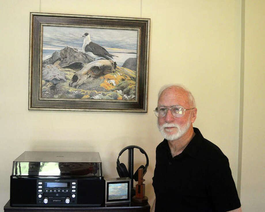 Wildlife artist Brent Langley poses with one of his paintings, depicting a polar bear and a jaeger (a sea bird) from a 2012 visit to Spitzbergen. Photo: Scott Marion | The Intelligencer