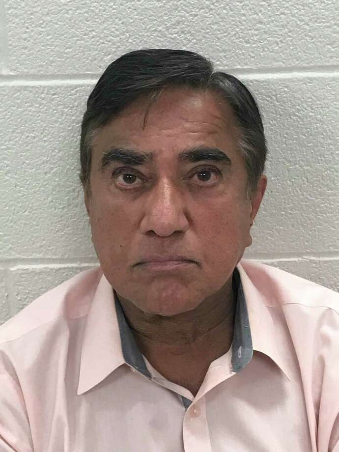 Dr. Ajay Ahuja, 60, of Stamford, was charged Wednesday with four counts of illegal distribution of a controlled substance. Photo: Stamford Police / Contributed