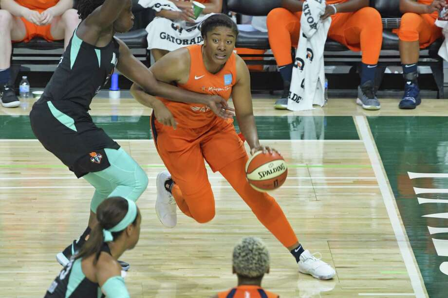 The Connecticut Sun's Morgan Tuck drives around a New York Liberty defender in a May 19 preseason game. Photo: Paul Buckowski / Albany Times Union / (Paul Buckowski/Times Union)