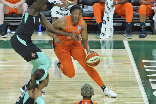The Connecticut Sun's Morgan Tuck drives around a New York Liberty defender in a May 19 preseason game.