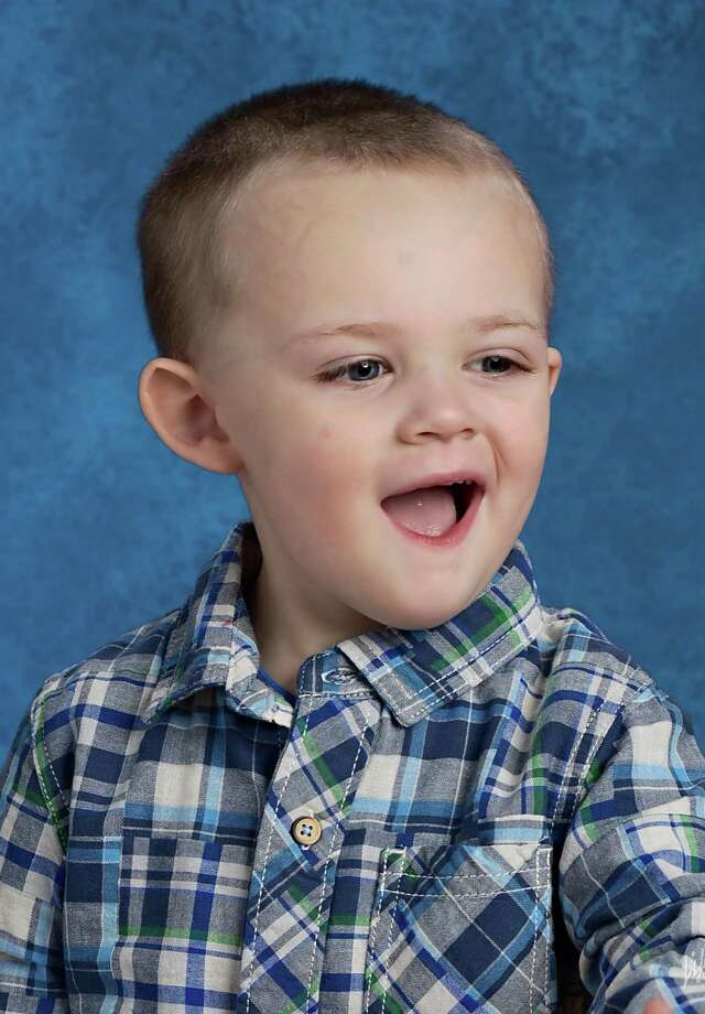 Melissa and Doug Pecor of Torrington, are hoping that a stem cell treatment at Duke University will help their son Matthew, 5, develop his speech and motor skills. Matthew has autism. Photo: Contributed Photo